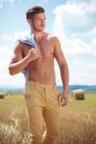 Topless man outdoor looks away Stock Photo