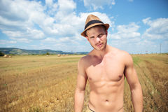 Topless man outdoor posing with hat on head Stock Photography