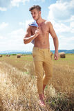 Topless man outdoor walking and looking away Royalty Free Stock Images