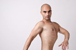 Topless man posing weird, enhancing his chest. Royalty Free Stock Image