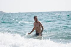 Topless Man on Sea royalty free stock photos