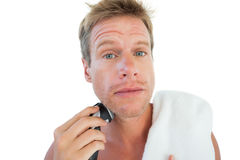 Topless man shaving his beard. On white background Royalty Free Stock Photography
