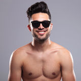 Topless man smiles for you Stock Photo