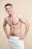 Topless man standing with towel on hips Royalty Free Stock Images
