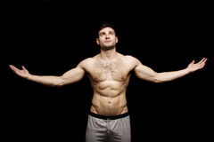 Topless man stood with his arms outstretched Royalty Free Stock Photo