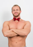 Topless man wearing a red neckbow and smiling Stock Photo