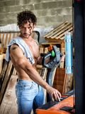 Topless man in workshop Royalty Free Stock Photos