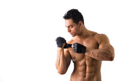 Topless Muscled Man Wearing Gloves for Workout Stock Images