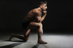 Topless Muscular Man Sitting in a Yoga Position Stock Images