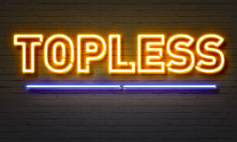 Topless neon sign on brick wall background. Royalty Free Stock Photos