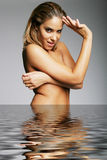 Topless nude woman smiling in water - spa Royalty Free Stock Image