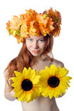 Topless redhead girl with a wreath of colorful flowers Stock Photo