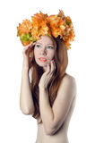Topless redhead girl with a wreath of colorful flowers on her he Royalty Free Stock Photography