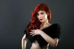 Topless Redhead Woman Covering Her Breasts With A Black Fur Coat Royalty Free Stock Photography