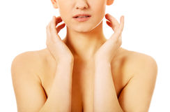 Topless slim woman covering her breast.  Royalty Free Stock Image