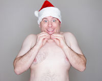 Topless smiling santa. Happy Man smiling during christmas time Stock Images