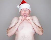 Topless smiling santa Stock Images