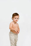 Topless toddler boy. Cute unsure topless toddler boy with necklace, isolated Stock Photo