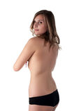 Topless woman body covers her breasts. Back view Stock Photography