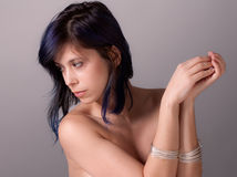 Topless Woman With Bracelets. An image of an attractive young woman with silver bracelets Royalty Free Stock Images