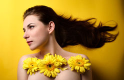 Topless woman covered with flowers Royalty Free Stock Photo