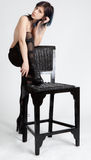 Topless Woman in Cut Out Leggings Leaning on Chair Stock Images