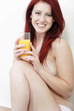 Topless woman enjoying fresh juice Royalty Free Stock Image