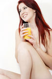 Topless woman enjoying fresh juice Royalty Free Stock Photography