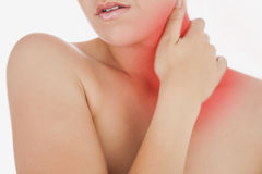 Topless woman massaging neck. Over white background Stock Photos