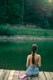 Topless woman on mountain forest lake. Royalty Free Stock Image