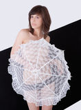 Topless Woman With Parasol. An image of a topless woman covered by a white lacy parasol against a black and white background Stock Image
