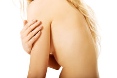 Topless woman touching her arm Royalty Free Stock Photo