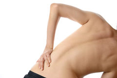 A topless woman use hand touch on her back pain isolated on whit Stock Photo