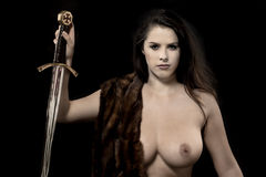 Topless woman warrior. Royalty Free Stock Image