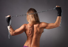 Topless women from behind with chains Stock Photography