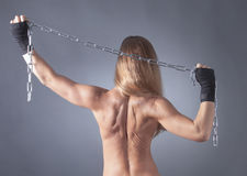 Topless women from behind with chains Royalty Free Stock Image