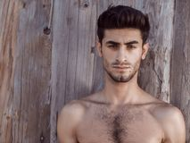 Handsome topless young man outdoors Stock Photo