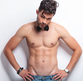 Topless young man with hands on hips Royalty Free Stock Photography