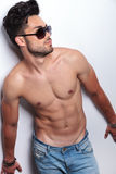 Topless young man looks away Stock Photography