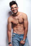Topless young man looks at you with hand on crotch royalty free stock images