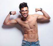 Topless young man showing off with biceps Stock Photography
