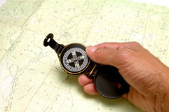 Topo Map & Compass. Topography map with hand holding compass Royalty Free Stock Photos