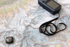 Topo map with GPS and compass. Topo map of Alps around Mont Blanc with GPS device and small compass royalty free stock images