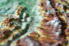 Topographic Map. A macro photo of Topographic Map relief map with a focus on a valley town surrounded by mountains Stock Images