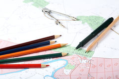 Topographic map of district. With a measuring instrument and pencils Stock Photo