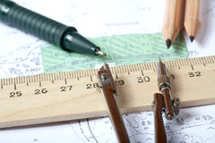 Topographic map of district with  instrument. Topographic map of district with  measuring instrument,  ruler and a pencil Royalty Free Stock Image