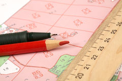 Topographic map of district with  ruler. And a pencil Royalty Free Stock Image