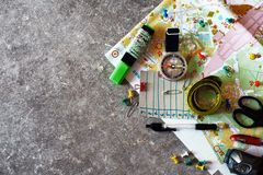 Topographic map for orienteering. Top view of colorful topographic map for orienteering or rogaining  sport and accessories - lamp, compass, pens, pins - with Royalty Free Stock Images