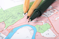Topographic map with pencils Royalty Free Stock Photography