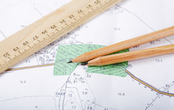 Topographic map and pencils. Close up Stock Photos